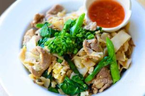 Simple pan fried rice noodles with Chinese broccoli and pork.